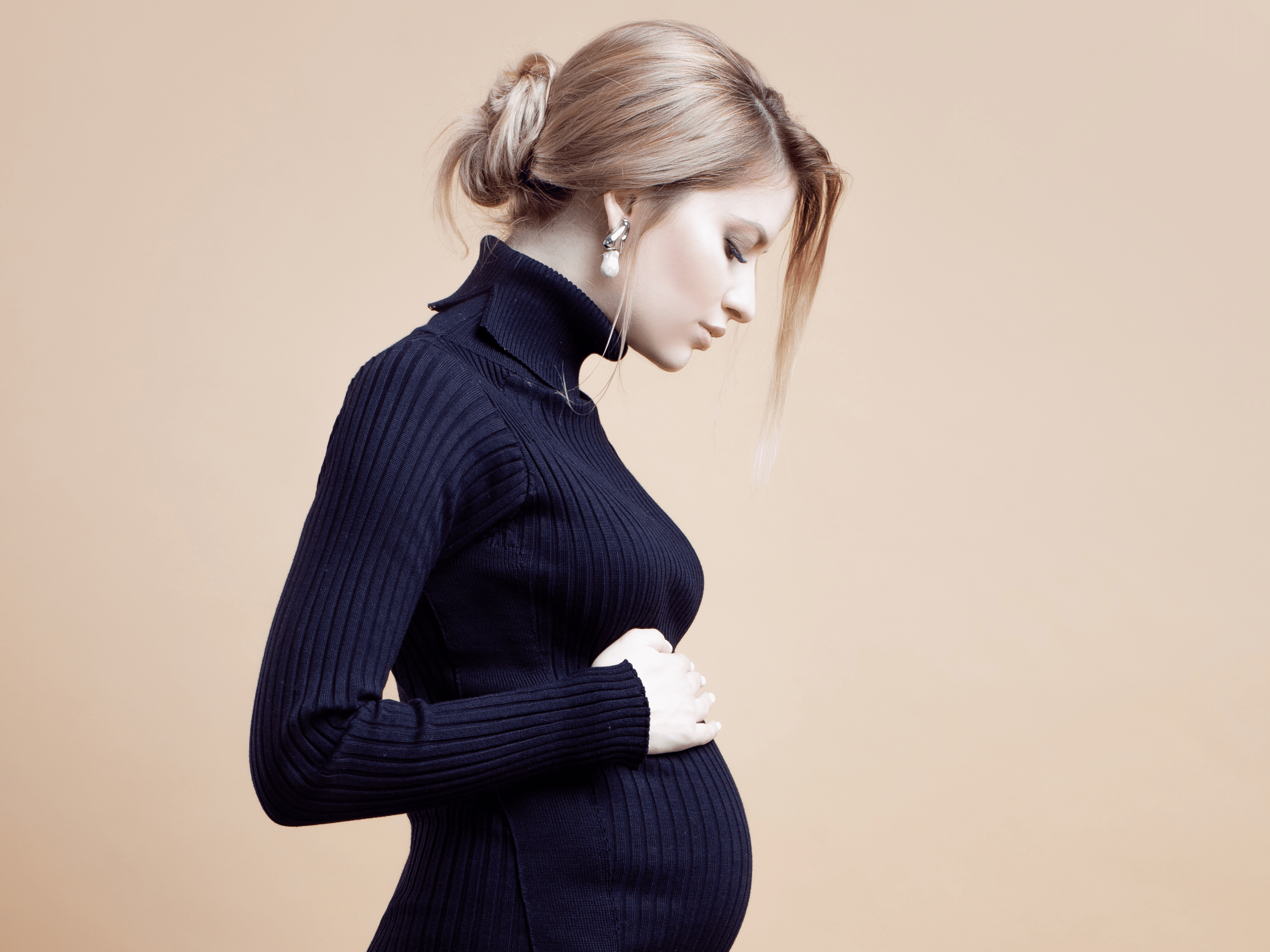 young pregnant woman in dress