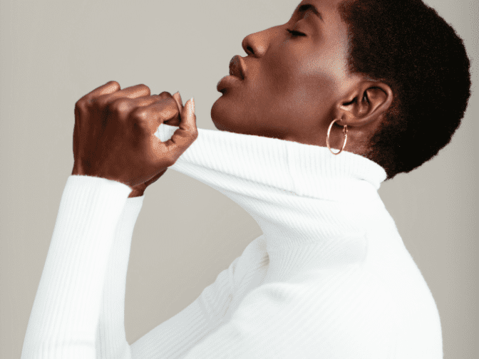 African American woman in white turtleneck