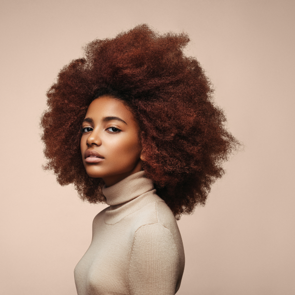 Young African American woman in beige turtleneck