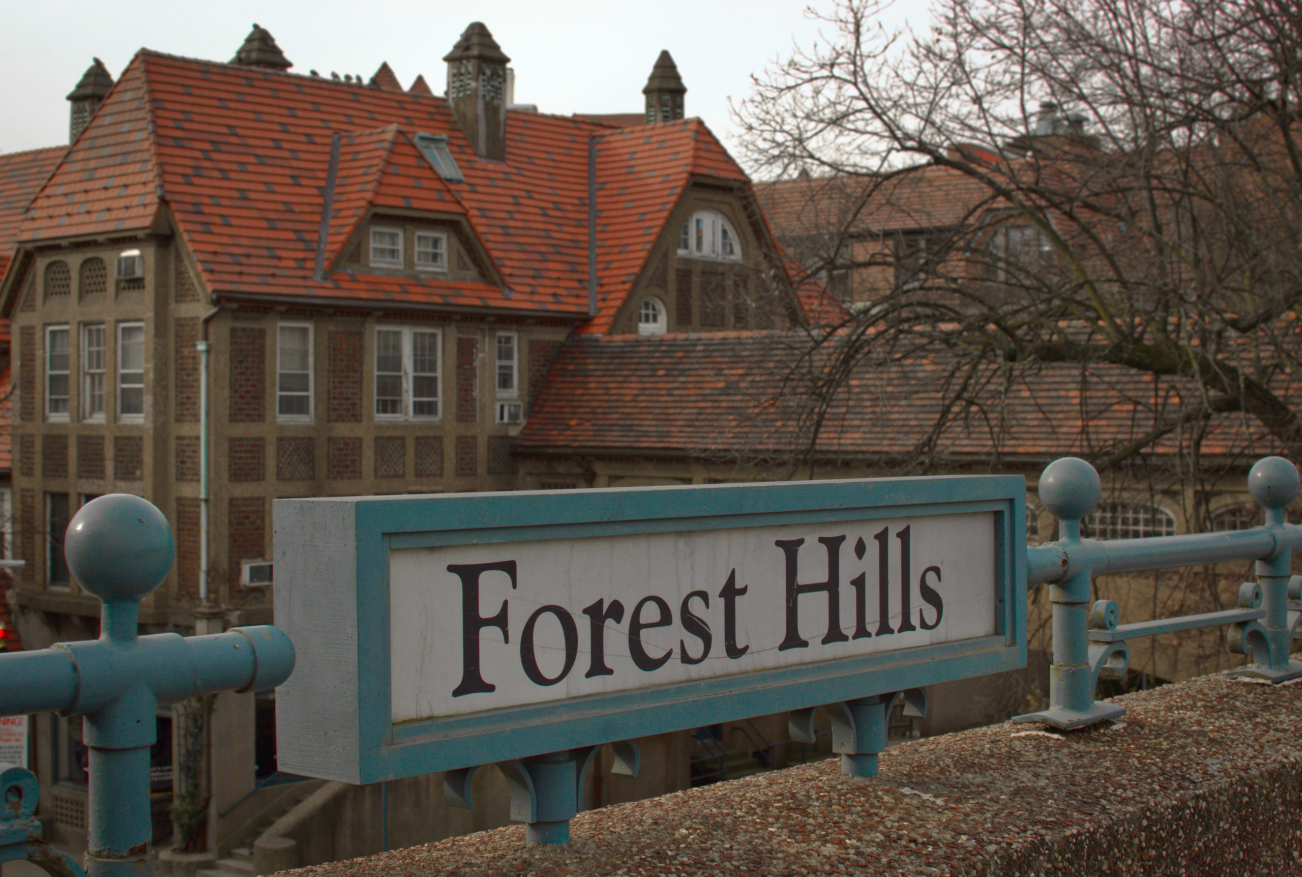 Forest hills sign with building in background