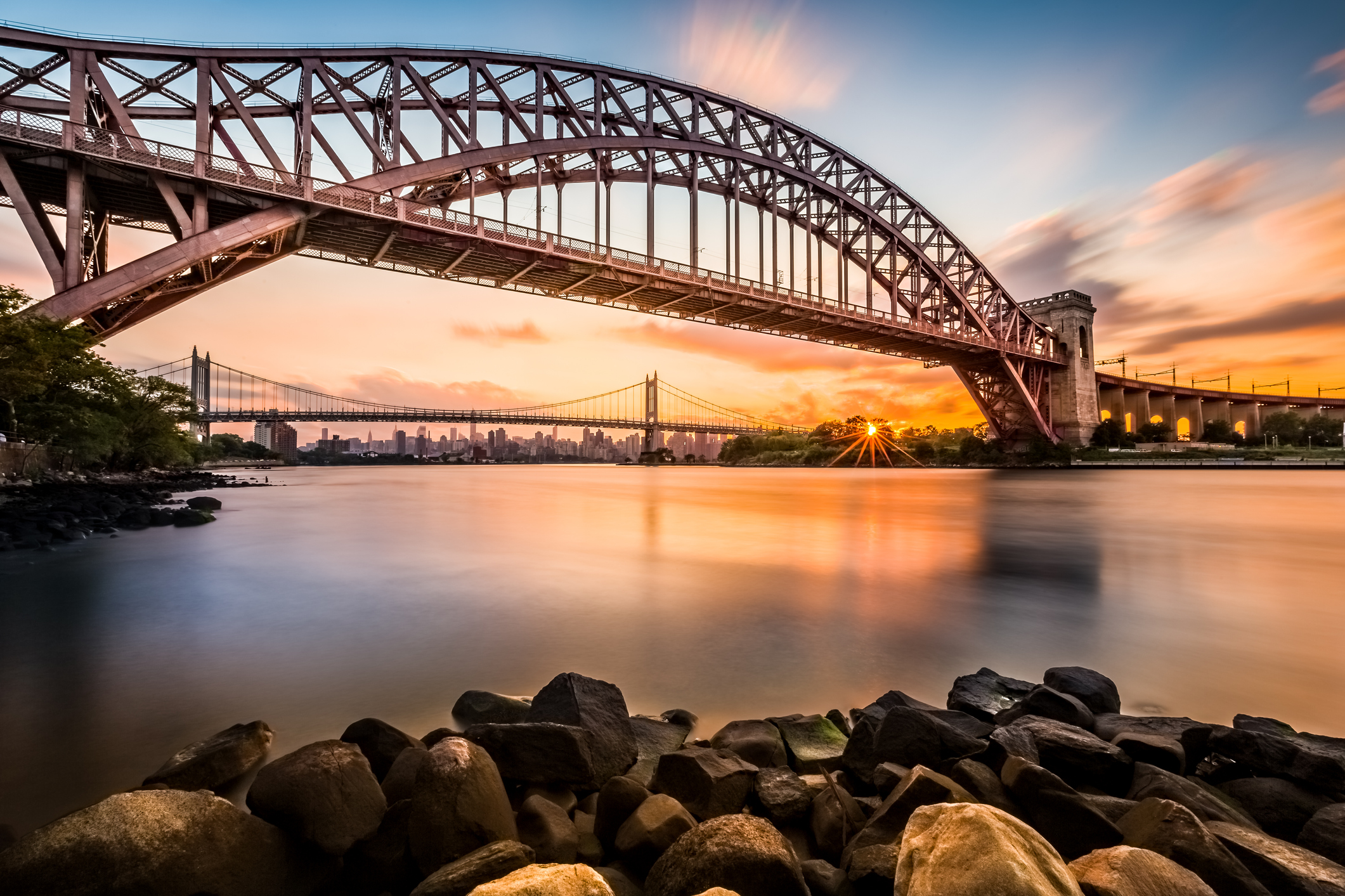Hell Gate and Triboro bridge at sunset, in Astoria, Queens, New York